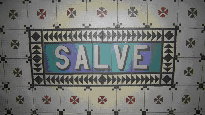 In 2010 I saw this mosaic of the Latin term salve, a once common greeting, at the entrance of a church building in Paris. (I'm sorry, I can't remember which church!)